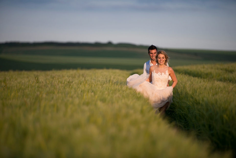 bridal-couple-fun-chasing-each-other